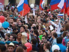 Зрители во время праздничного концерта на Красной площади © Сергей Фадеичев/ТАСС